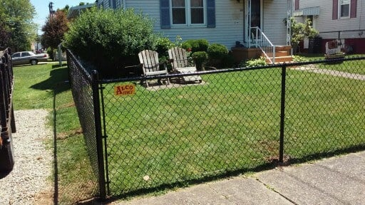 black chain linked fence three foot tall around a front yard