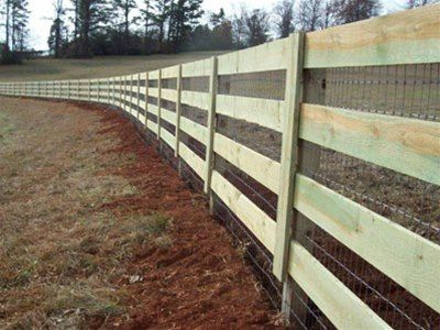 corral fence enclosing a pasture with welded wire added
