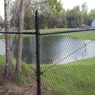 seven foot black chain link fence commercial surrounding pond