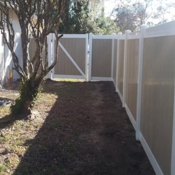 tan vinyl fence enclosing a yard