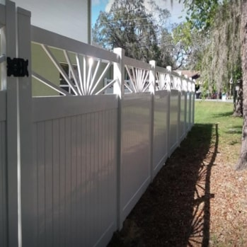 white vinyl fence on side yard of a home