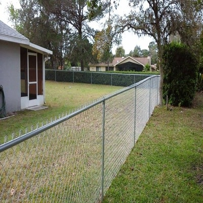 three foot tall chain link fence around a house
