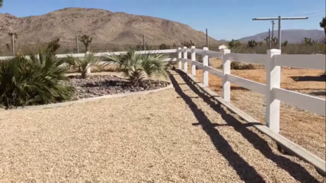 ranch rail fencing in desert setting